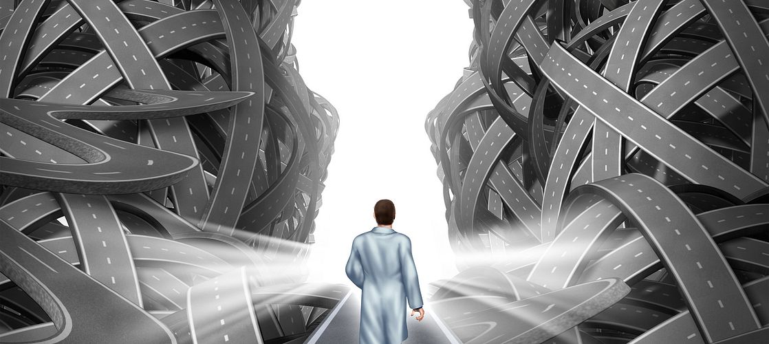 Medical research and development concept with a hospital doctor in a lab coat walking towards a group of tangled roads with a keyhole opening as a metaphor for success in medicine and health care