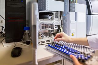 a laboratory scientist prepares samples for download to High-performance Liquid Chromatograph Mass Spectrometry