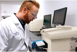 Lab technicians working to implement a rapid microbial method into their global processes