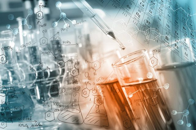 Abstract image of a researcher dropping the clear reagent into test tube with periodic table and chemical equations background.