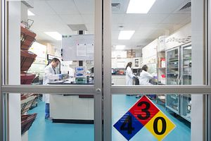 Scientists working in pharmaceutical formulation laboratory designed to eliminate cross-contamination and suitable for the preparation of preclinical dosing formulations of any batch size