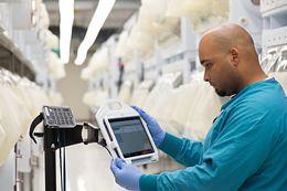 technician monitoring animal health in a vivarium