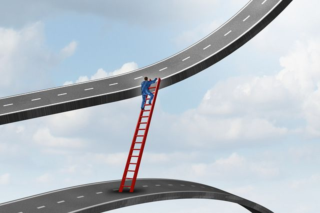 animated drawing of person climbing ladder between two roads in the sky