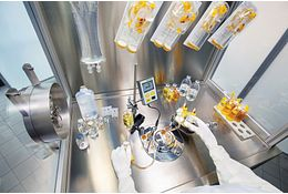Quality control microbiologist working in biological safety cabinet for validation of microbiological methods
