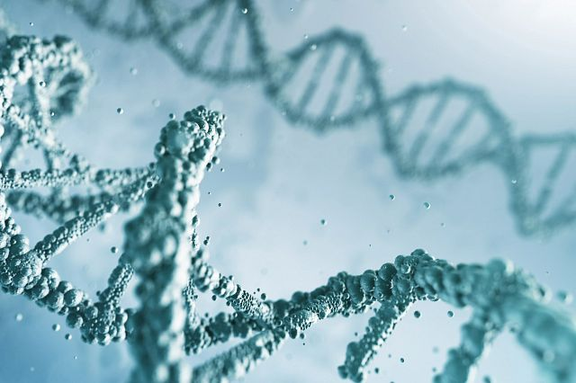 animated rendering of DNA double heliz in light green bubbles.jpg